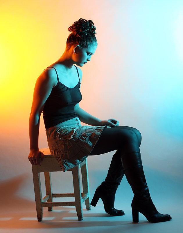 Portrait of the beautiful girl in studio